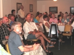 In audience: Front row: LaVern Pritchard, Jack Wesley, Julie Peterson. 2nd row: Bernie Dahl, Les Miller. Standing: Chris